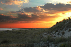 Cape May at Sunset (Jim Frazier) Tags: ocean road trip travel sunset sea wild vacation sky orange plants cloud sun plant seascape beach nature water grass weather clouds fence wow skyscape landscape bay harbor newjersey sand flora october scenery skies v100 dusk roadtrip 2006 fv5 f10 shore fv10 capemay f3 preserve f5 naturepreserve usfws refuge breakwater nationalwildliferefuge fws nwr v200 gardenblog v500 v1000 q4 v2000 capemaynationalwildliferefuge jimfraziercom wmembed