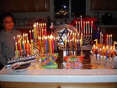 Sabi and the lights (msabcmom) Tags: family candles hanukkiah hanukka2006
