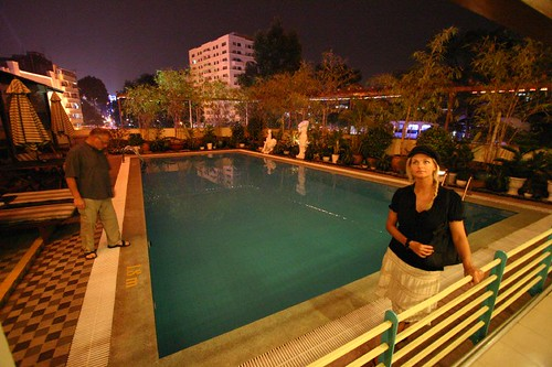 My sister Julia and dad at the outdoor pool. Hotel Metropole, Saigon.