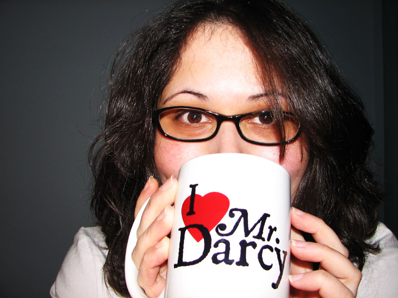 Woman drinking from Mr Darcy coffee mug