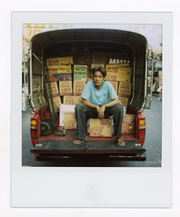 Leo (Mister Phill) Tags: street travel portrait man thailand asia sitting bangkok south save3 save7 save8 save save2 east save9 save4 save5 save10 save6 siam package savedbythedeltemeuncensoredgroup khaosanroad ticketed save11 save13 polaroid600film polaroidslr680 sexyleogirl displayedinstant100best beerdeliveryman takingacigarettebreak 1photoperyearmay92007 unanisave