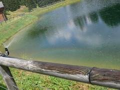 Dolomiti Lake - Rainbow and Reflection (ccr_358) Tags: light italy lake mountains reflection water fence rainbow colours di alto dolomiti alpe sprinkle adige siusi sudtirol ccr358