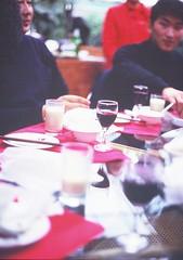 Blueberry Wine (silverlinedwinnebago) Tags: china food woman man lunch restaurant asia wine drink chinese blueberry waitress february server 2007 yichun