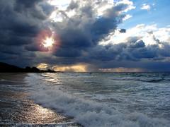Shine on (esther**) Tags: ocean blue light sunset sea sun beach water clouds dark sand bravo mediterranean waves wind interestingness1 topf300 greece shore excellent splash topf150 topf100 rhodes topf200 iloveit topf350 welltaken thebestbravo specland beautifulcapture abigfave anawesomeshot grangrupo interetsingness1 granfoto frhwofavs