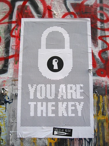 poster graffiti -- a padlock with the words, 'You are the key'