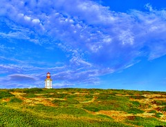 Clouds over the lighthouse (antonioVi (Antonio Vidigal)) Tags: blue lighthouse green portugal clouds canon 350d cabo surreal cape 1855mm hdr fromraw espichel abigfave anawesomeshot