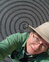 2007: a spiral journey begins (zen) Tags: portrait selfportrait hat self tile spiral pavement hats ofme armslength mai zen museumoftheamericanindian 365days 20061228 52ndyear armslengthportrait 52ndyear35