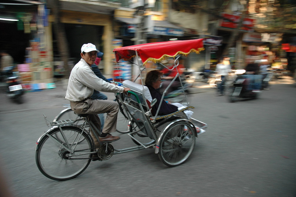 """Cyclo"" driver in Hanoi by graeme_newcomb, on Flickr"