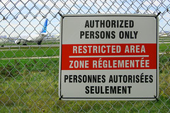 denied (1ncognito) Tags: ontario canada green field grass sign clouds plane canon fence airplane 350d airport air jet double chain 55mm posted area link only etobicoke kit persons 1855 restricted personnes zone pearson yyz authorized transat seulement reglementee autorisees
