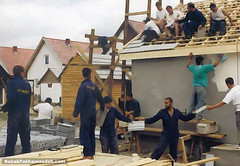 The human chain building the roof