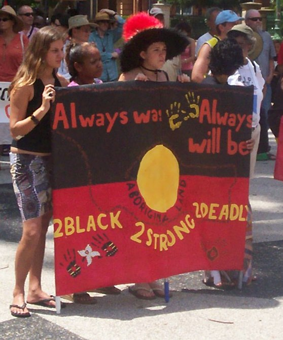 Teenagers with banner - Invasion Day Rally and March, Parliament House, George St, Brisbane, Queensland, Australia 070126