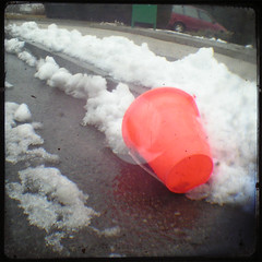 Orange in the Snow (Mixxie Sixty Seven) Tags: street winter orange snow trash catchycolors toy bucket junk pavement slush litter plastic february pail ttv veiwfinder recylced throughtheviewfinder discardedtoys thecolororange
