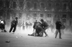 Student demonstration, The street victory, Lyon, France. (xavier .) Tags: street city urban france fog town blackwhite big fight riot hurt student cops lyon brother foggy photojournalism gaz streetlife social battle victory gas demonstration violence conflict bleeding tension cip baton furies arrest policeman manifestation politic truncheon violent endoftheworld teargas swaddle urbanwar contrat flyingobject placebellecour attaque streetbattle cosh contestation professionnelle bombard bludgeon overcharge matraque milice balladur civilcops bellecoursquare arestation batoncharge harshlycriticize fliccivil contratdinsertionprofessionnelle pressionpopulaire dinsertion