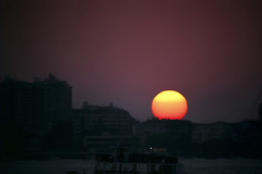 Orange in Plum (Anindo Ghosh) Tags: sky india film water skyline canon cityscape bigma indian highcontrast bombay fujifilm maharashtra mumbai superia400 500mm eos3 400iso in canoneos3 c41 sigma50500 anindo anindoghosh fujicrystal400