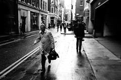running man (travelight) Tags: street leica people blackandwhite bw london film topf25 monochrome movement action soho running printed contrejour m7 overcoat sr46 cotcmostfavorited abigfave nothcsp travelight