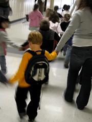 kid (DothNotWisdomCryOut) Tags: portrait yellow kid blurry backpack preschool desaturate holdhands