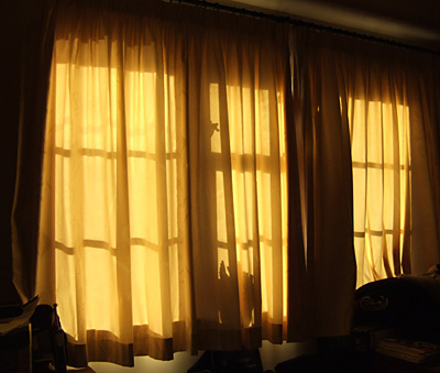 Morning light through the bedroom curtains