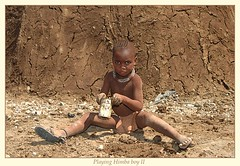 himba boy (Marijke-s) Tags: africa people animals children dessert african culture tribal safari zimbabwe afrika botswana tribe ethnic namibia tribo zuid himba afrique ethnology tribu namibie marijkes tribus ethnie