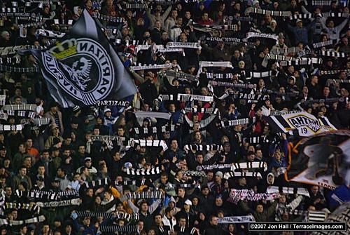 Partian fans waving scarfs