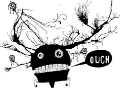 black and white line drawing of a monster with a speech bubble with the word ouch in it