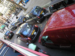 Taxi! (kamomeel (Hend AbduAllah)) Tags: street uk greatbritain red black streets london bicycle europe unitedkingdom taxi crowd bustour