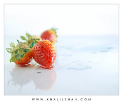 Delicious ? (khalilshah) Tags: blue pakistan red reflection green water glass drops strawberry nikon bravo punjab dots coolest 10faves d80 nikonstunninggallery artlibre superaplus ppgpod superhearts