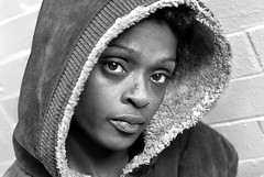 sunday girl (stoneth) Tags: poverty sf sanfrancisco california ca street portrait people urban blackandwhite bw woman white black eye girl beautiful face closeup female blackwhite eyes nikon day sad poor young photojournalism streetportrait forsakenpeople social impoverished human jacket hood d200 grayscale nikkor 50mmf18d 2007 destitute streetshot