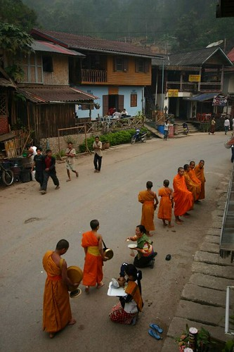 Early morning in Pakbeng. Monks collecting food.