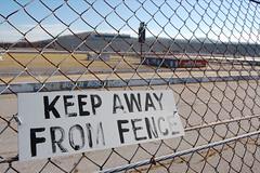 Keep away. (shiny red type) Tags: sign racetrack fence northcarolina nascar speedway northwilkesborospeedway