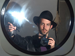 A Self Portrait Grasping My Metz Mecablitz Hammerhead Flash (Andrew Dyer) Tags: portrait selfportrait me hat d50 nikon nikond50 fedora metz andrewsphotos cl3 mecablitz cullmann strobist metzmecablitz metzmecablitzcl3 cx40 cullmanncx40