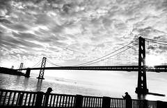 The Fisherman and the Bridge (Thomas Hawk) Tags: sanfrancisco california city morning bridge sky blackandwhite bw usa water silhouette clouds sunrise blackwhite fisherman unitedstates suspension 10 unitedstatesofamerica fav20 baybridge sanfranciscobay daybreak fav10 natureshand