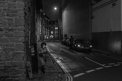 Back streets....... (Dafydd Penguin) Tags: side street photography back streets bristol urban night shots after dark scene woman car star light high iso very blackandwhite blackwhite black white monochrome bw city centre uk england britain demark nikon df nikkor 35mm af f2d