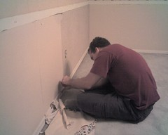 Kevin works on stripping some wallpaper