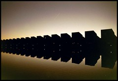 Sunset (Dit is Suzanne) Tags: 04122006 nederland netherlands нидерланды groningen гронинген deheld handiekmannkade architectuur architecture архитектура zonsondergang sunset закатсолнца weerspiegeling reflection отражение ©ditissuzanne 1on1reflections canoneos300 35mm vinex views2200