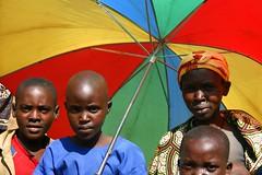 kids w umbrella (LindsayStark) Tags: africa travel people war rwanda humanrights genocide humanitarian humanitarianaid postconflict waraffected conflictaffected