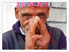 namaste! (exhibitj) Tags: nepal portrait people man face d50 palms nikon clasp pokhara nepali namaste 1870 1on1peoplephotooftheday
