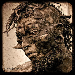 The Man of Mud (Nicolas Zonvi) Tags: street portrait brown man tree art monster statue arbol scary mud retrato roots clay estatua baum santelmo barro livingstatue raices abigfave artlibre themanofmud canonefs1855mm3556 nicolaszonvi