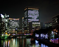 Nakanoshima (JanneM) Tags: city light reflection water japan night buildings canal hall office jan   osaka kansai nakanoshima  morn moren janmoren janmorn