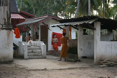 monks ready to take a shower at Wat Visoun (nanamoose) Tags: laos laungprabang