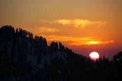 End of day (usamabhatti) Tags: travel trees sunset sky orange sun snow mountains nature silhouette clouds nikon holidays d70s swat blueribbonwinner malamjabba supershot interestingness48 outstandingshots 25faves abigfave impressedbeauty aplusphoto