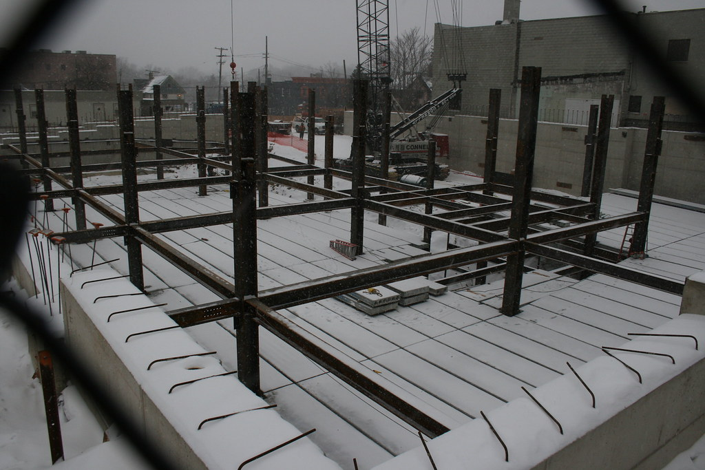 Laying concrete floor panels