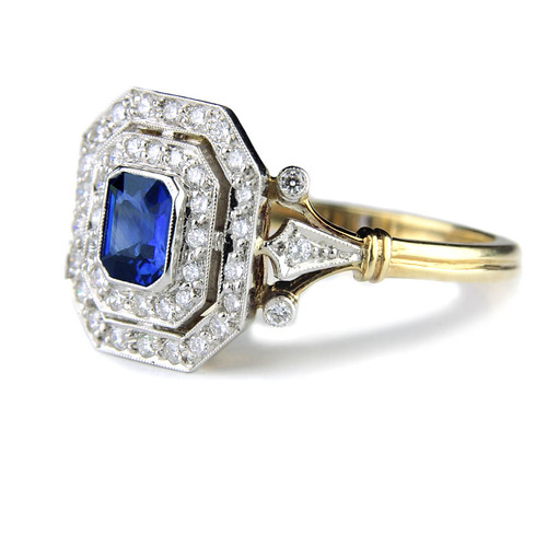 An emerald cut sapphire and diamond engagement ring