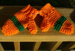 orange and green striped mittens