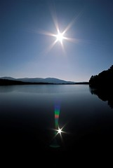 Into the sun (The Flying Pie) Tags: sun reflection water wow scotland nikon d200 speyside lochgarten
