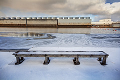 Have a (Cold) Seat (matthewkaz) Tags: bench dam clouds sky mooresdam winter snow ice grandriver river water powerplant bwl lbwl eckertpowerplant eckertpowerstation ottoeeckertstation eckertstation moorespark inghamcounty michigan coolingtowers 2016 buoy buoys