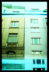 Tiled/Mirrored () Tags: vienna houses windows urban reflection slr film 35mm buildings austria mirror interestingness xpro crossprocessed slide facades slidefilm powerlines tiles analogue top20windows tbp mz5 top20reflections e6inc41 interestingness426 explore26dec06 colourpositive