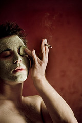 esthetician (puja) Tags: esthetician lloyd facemask green red 50mm canondigitalrebel 350d livingroom lenstagged canon50mm18 canon50f18 50mm18 cucumberfromsubway cigarette tenpositive topf25 skincare topf50 myapartment topf100
