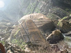 Huge boulder that may have been torn away from the rocky cliffs by the falls