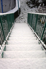 Photo of stairs covered in snow