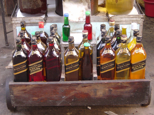 Herb Oil in Whisky Bottles at Empress Market Karachi